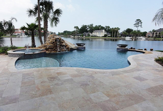 classico-travertine-tiles-around-a-swimming-pool