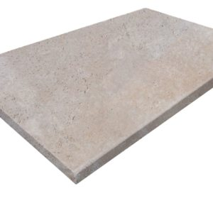 ivory travertine unfilled and tumbled pool coping